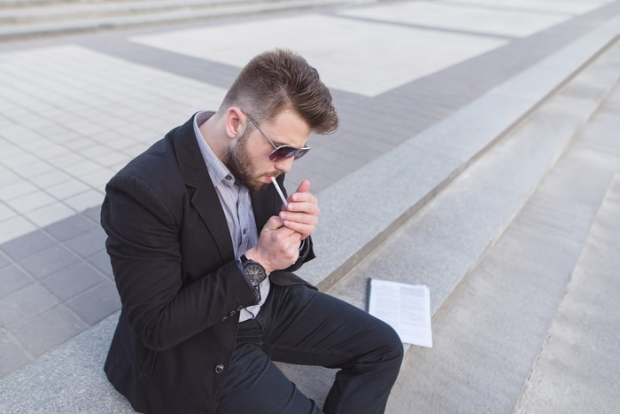 Business Man Smoking