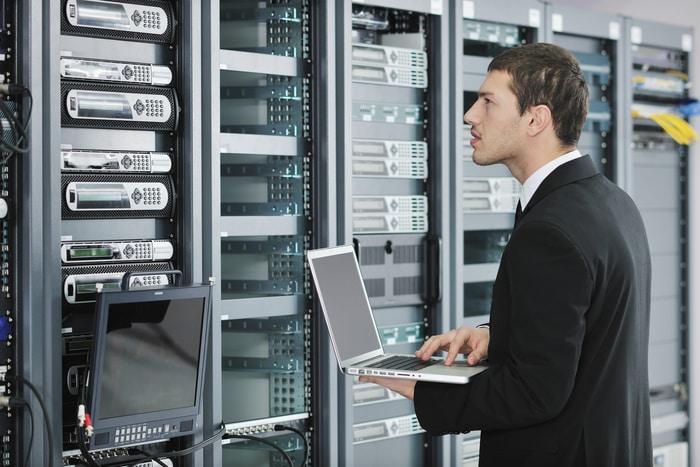 Engineer Working On Network Servers