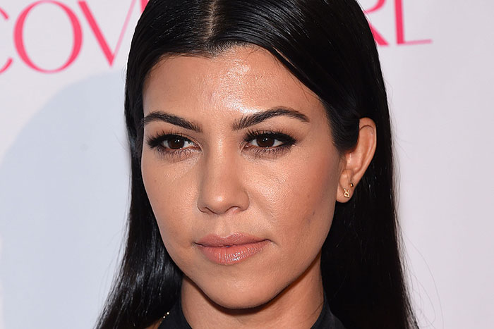 "Kourtney Kardashian Draws Public Ire for Wearing a ""Vote Kanye"" Cap to Endorse Brother-In-Law for President"